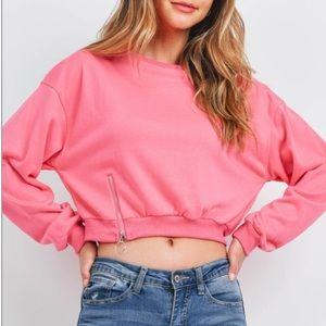 Bright pink cropped sweatshirt zip detail pullover